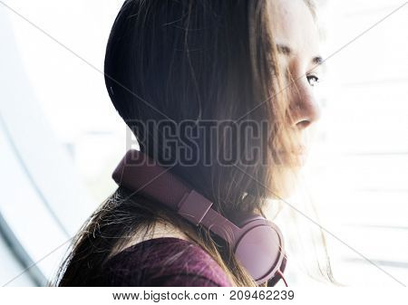 A woman with headphone