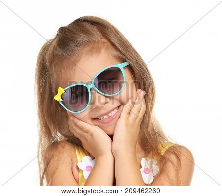 Adorable little girl with sunglasses on white background