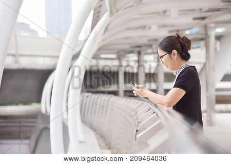 Chinese Business Woman using smart phone. copy space.