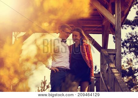 Portrait Of Happy Young Couple In Love On Blurred Nature Background In Autumn. Vintage Tone