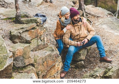 Smiling Couple In Autumn Forest