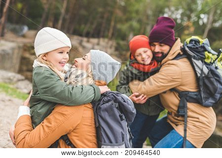 Parents Hugging Children
