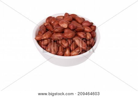 Peanuts in a white bowl on a white background. Isolate.