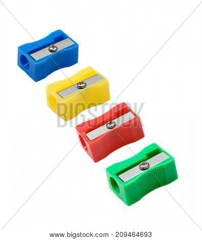 Four pencil sharpener with differents colors isolated on a white background