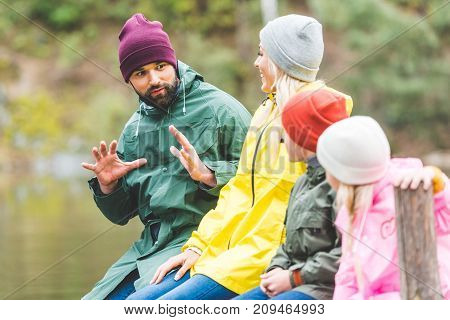 Family Spending Time In Forest