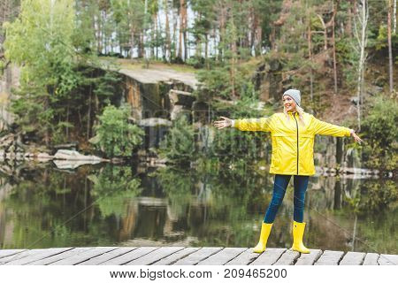 Smiling Woman In Raincoat