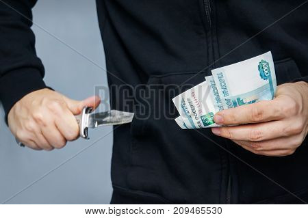 Robber With Knife In Hand And Russian Money