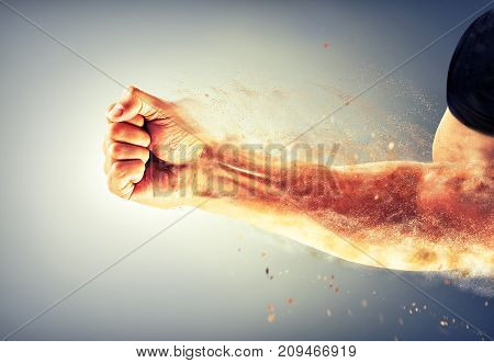 a strong man's hand bent into a fist crumbles on impact. Boxing, kick
