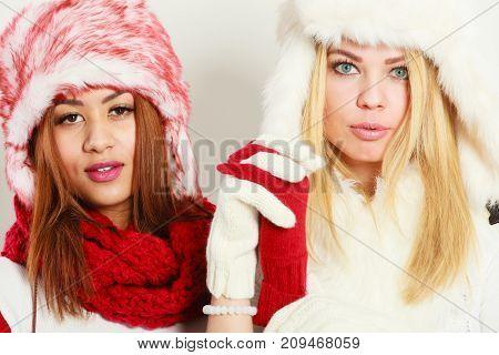Two Girls In Warm Winter Clothing Portrait.