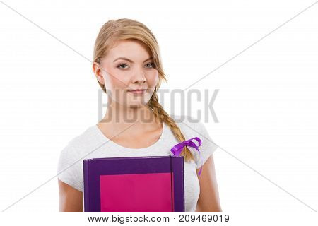 School education concept. Young teenage student with braid holding books going to study.