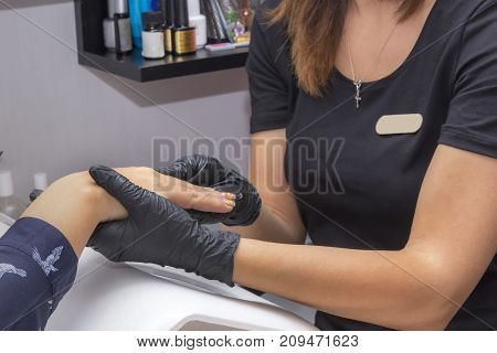 Hand Care Treatment- a specialist examines a hand