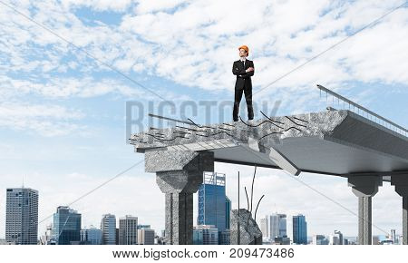 Confident engineer in helmet looking away while standing on broken bridge with cityscape on background. 3D rendering.