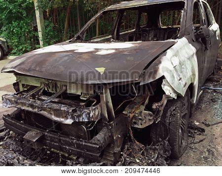Burned or burnt luxury car, car damaged by arson fire