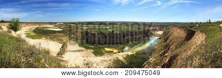 Panoramic view of opencast mining quarry, industrial landscape, limestone mining - view from above