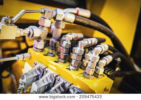 Black wires attached to yellow machine. A close-up industrial shot. Railway industry