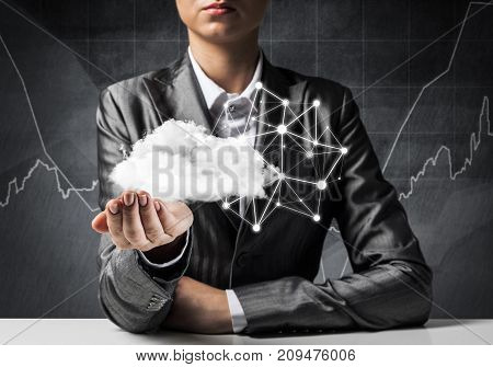 Businessman in suit keeping cloud with network connections in hands with business sketches on background. 3D rendering.