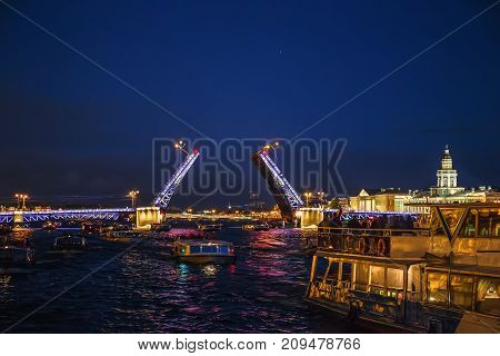 Landscape with open Palace bridge, view from Neva river from boat, in St. Petersburg, Russia