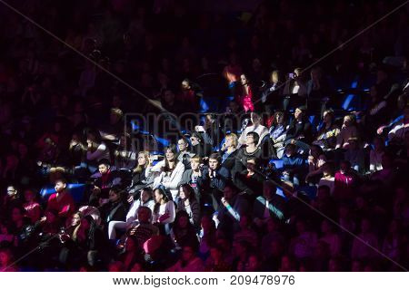 KYIV, UKRAINE - MARCH 19, 2017: Spectators lit by a spotlight during Deriugina Cup Gala Concert in Sports Palace
