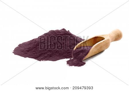 Acai powder and wooden scoop, isolated on white