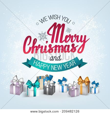 The handwritten phrase We wish you a Merry Christmas and happy New Year on a white background with gifts and boxes.EPS 10