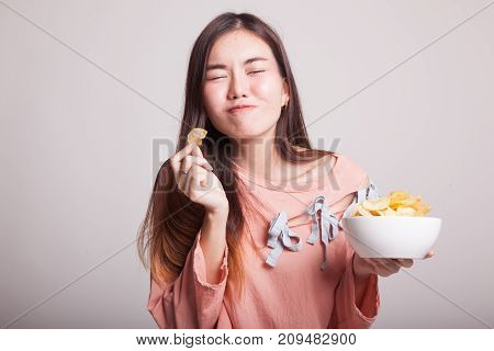 Young Asian Woman Eat Potato Chips.