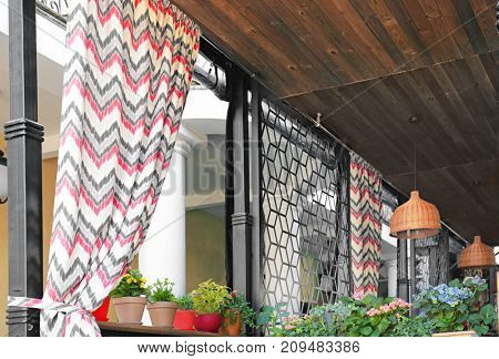 Open air cafe with curtains
