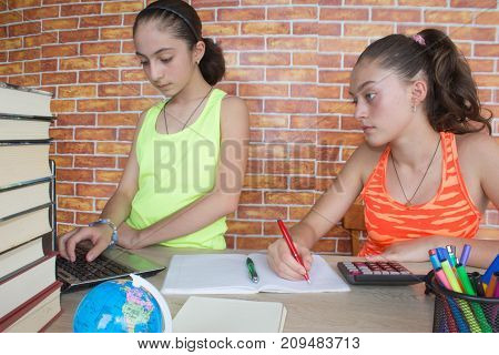 Two Girls with lots of books studying for exams. Thoughts education creativity concept