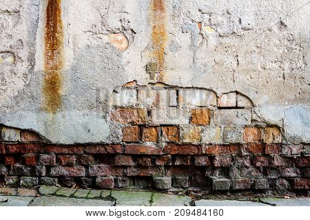 Old weathered street wall and a ground. Architecture detail background.