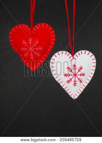 Christmas Decorations, Red And White Hearts On The Clothespin On A Black Background