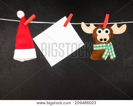 Christmas Decorations, Santa Claus Hat , Blank For Text, And Deer On The Clothespin