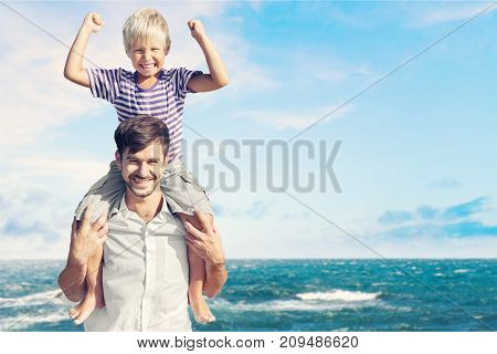Young son father elementary age color background sky