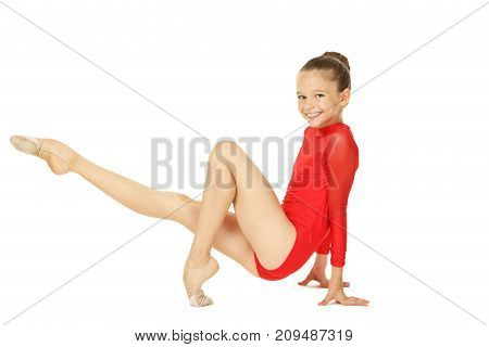 Young girl gymnast isolated on white background