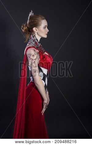 The Queen from child's fairy tale. Red Gorgeous Dress.