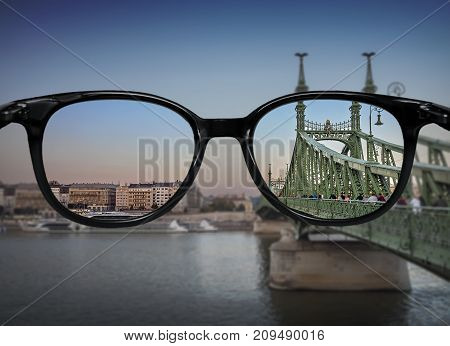 Clear Vision Through Glasses Over River Bridge Landscape