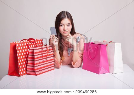 Young Asian Woman With Shopping Bag And Blank Card.