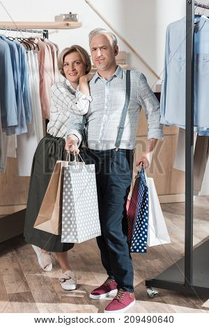 Couple With Shopping Bags In Boutique