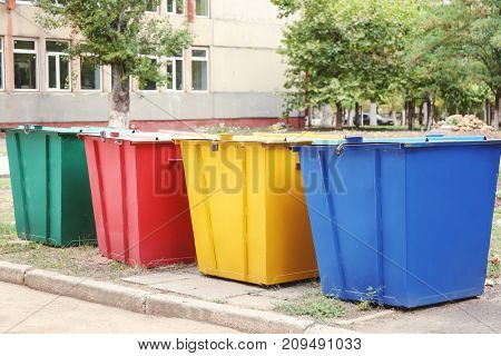 Recycling bins for different types of garbage outdoors