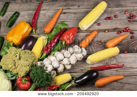 Photography of different vegetables on wooden table. Healthy food background.