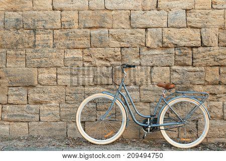 Retro bicycle near brick wall outdoors