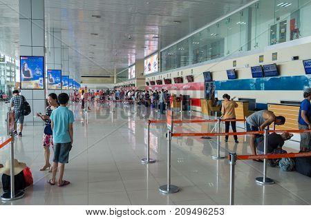 Hanoi, Vietnam - August 19, 2017: travellers inside the terminal of Noi Bai International Airport in Hanoi.