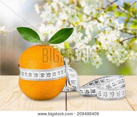 Fresh orange measuring tape healthy lifestyle low calorie natural food