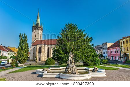 Neptune Fountain and Cathedral of Saint Nicholas in Presov. Slovakia, Central Europe