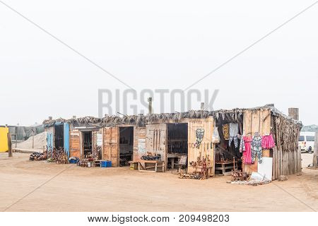 WALVIS BAY NAMIBIA - JULY 1 2017: Wood carving shops at the watefront in Walvis Bay on the Atlantic Coast of Namibia