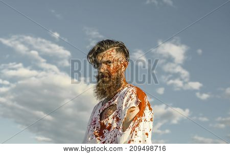 Halloween Man With Red Blood Splatters On Bearded Face