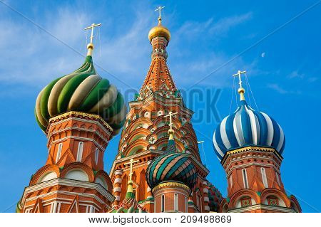 A view of Saint Basil's Cathedral in the morning with the moon on the backgraound Red Square Moscow Russia
