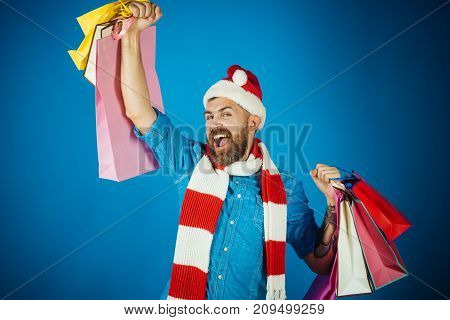 Christmas Hipster Hold Shopping Bags With Winner Gesture