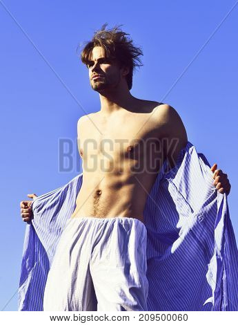 Caucasian Macho In Blue Striped Pajamas