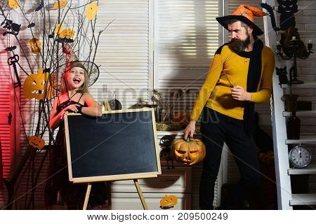 Halloween Party Concept. Father And Daughter With Halloween Decor.