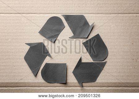 Symbol of recycling on cardboard background