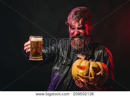 Halloween Man With Satan Horns Hold Pumpkin